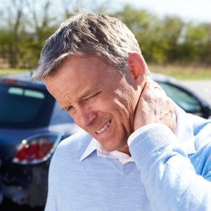 Victim from Motor Vehicle Accident Rubbing Neck