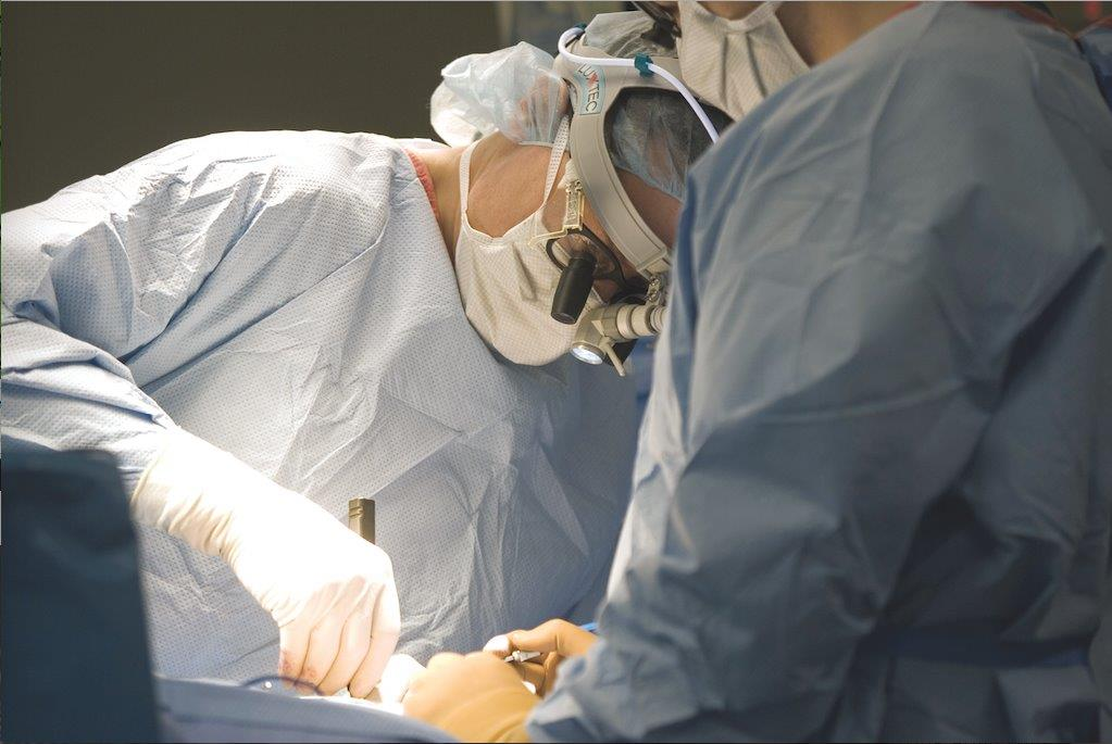 Surgeon operating on a patient.