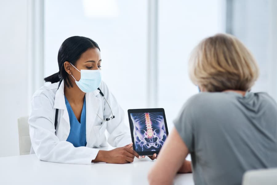 physician reviewing x-ray with patient